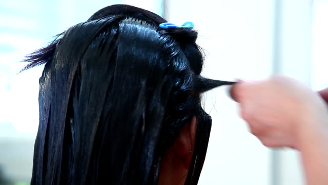 hair dresser used hair straight on woman's head - caucasian appearance stock videos & royalty-free footage