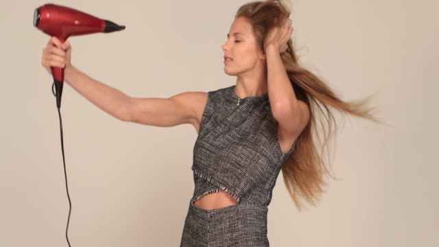 hair dryer - blow drying hair stock videos and b-roll footage