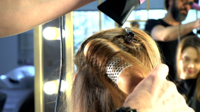 hair drying - blow drying hair stock videos and b-roll footage