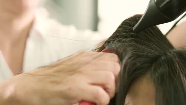 髪を乾かす  - ヘアケア点の映像素材/bロール