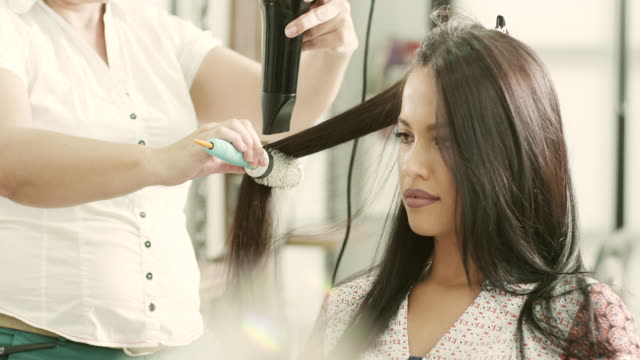 hair drying - beauty salon stock videos and b-roll footage