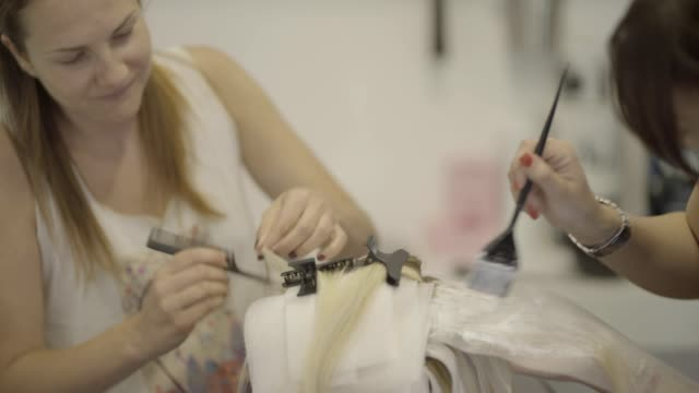 hair dying - hairdresser stock videos & royalty-free footage