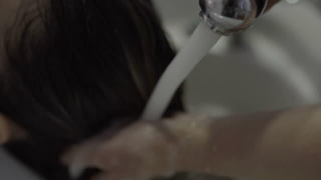 hair wash - washing hair stock videos & royalty-free footage