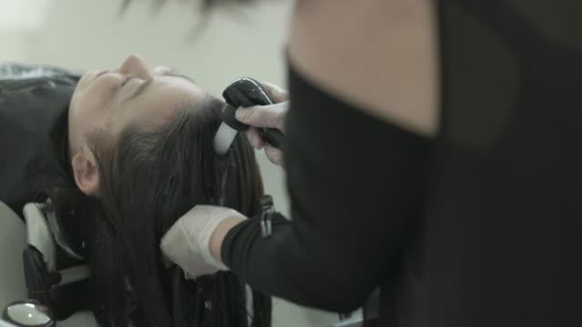 Hair washing at a salon. Japan