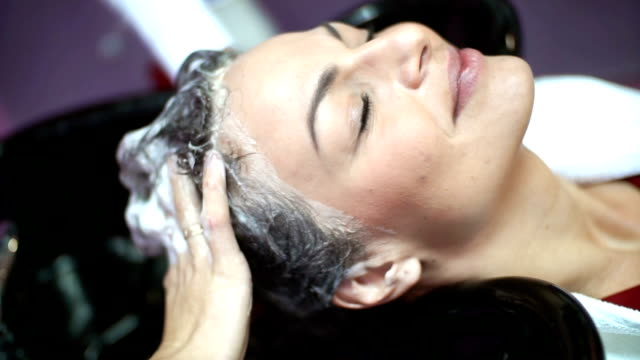 hair washing at a salon. - barber chair stock videos & royalty-free footage