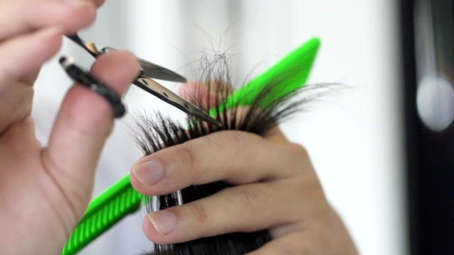 slo mo haircut in barber. - schere stock-videos und b-roll-filmmaterial