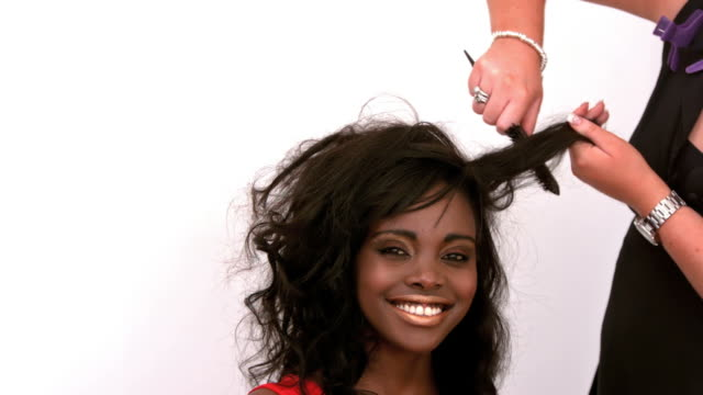 hairdresser backcombing womans hair - black hair stock videos & royalty-free footage