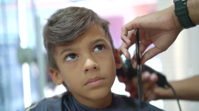 hairdresser cutting boy's hair - electric razor stock videos and b-roll footage