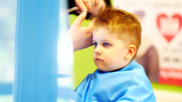 hairdresser cutting cute childs hair - baby boys stock videos and b-roll footage