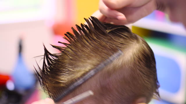 hairdresser cutting cute childs hair - cutting hair stock videos & royalty-free footage