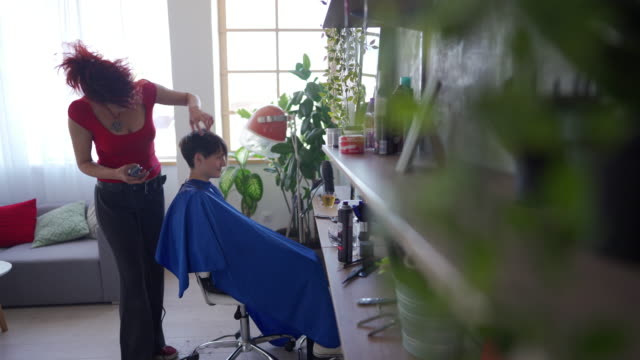 hairdresser cutting female client with electric razor - electric chair stock videos & royalty-free footage