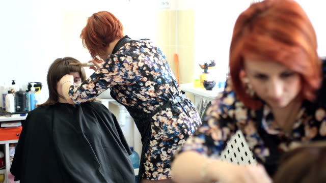 hairdresser cutting hair after coloring. - cutting hair stock videos and b-roll footage