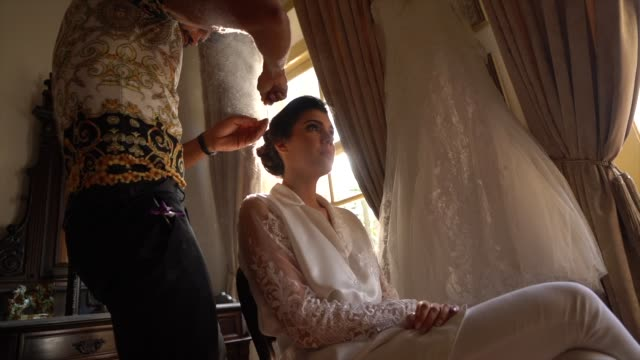 hairdresser doing bride's hair for the wedding ceremony - wedding ceremony stock videos & royalty-free footage