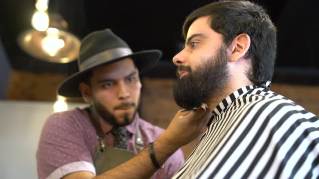 hairdresser grooming man's beard with scissors - beard stock videos & royalty-free footage