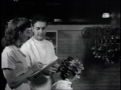 1946 MS hairdresser putting curlers in a woman's hair