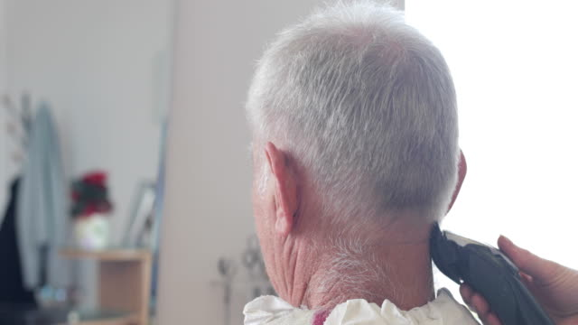 hairdresser shaving senior man's neck with electric razor - electric razor stock videos and b-roll footage