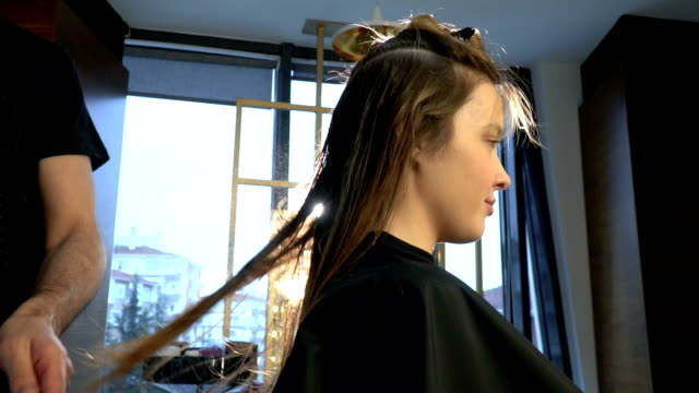 hairdresser spraying to hair of beautiful woman - hair conditioner stock videos and b-roll footage
