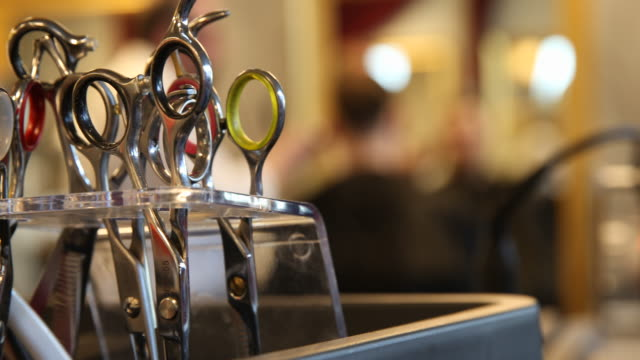 hairdresser works in an almost empty barber shop in berlin mitte on march 16, 2020 in berlin, germany. everyday life in germany has become... - barber stock videos & royalty-free footage
