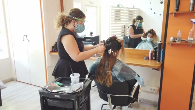 hairdressing during the covid-19 pandemic - beauty salon stock videos & royalty-free footage