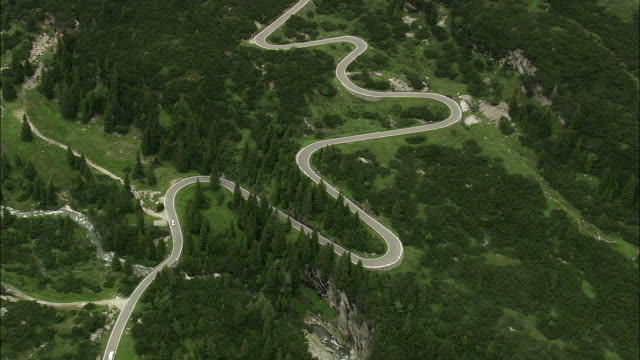AERIAL Hairpins bends in Alpine landscape, Graubunden, Switzerland