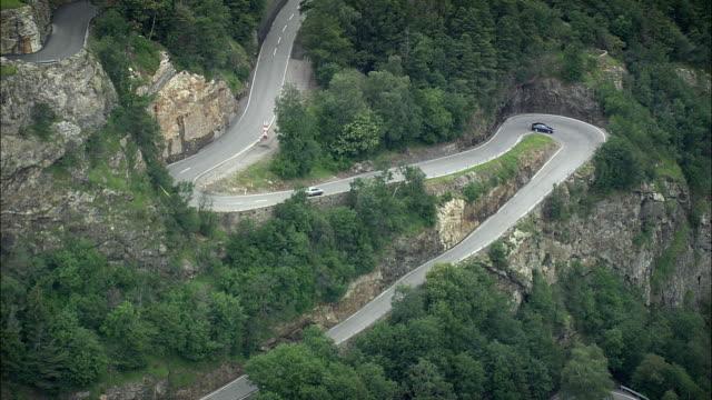 aerial zo hairpins bends in alpine landscape, vaud, switzerland - winding road stock videos & royalty-free footage