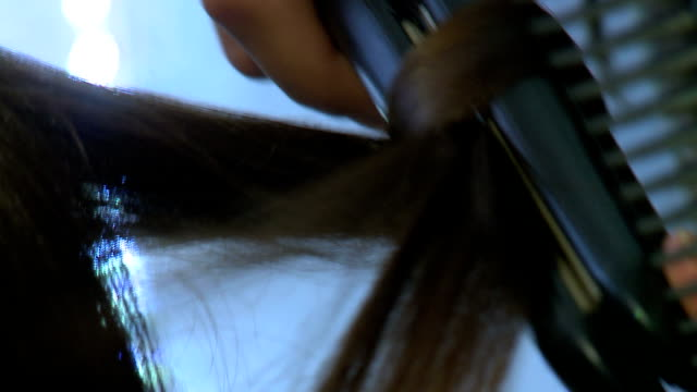 hairstylist straightening hair - hair straighteners stock videos and b-roll footage