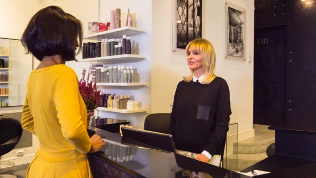 ms hairstylist talking to customer in salon - hairdresser stock videos & royalty-free footage