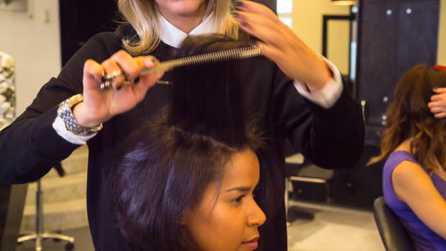 cu hairstylists cutting customer´s hair in salon - hairdresser stock videos & royalty-free footage