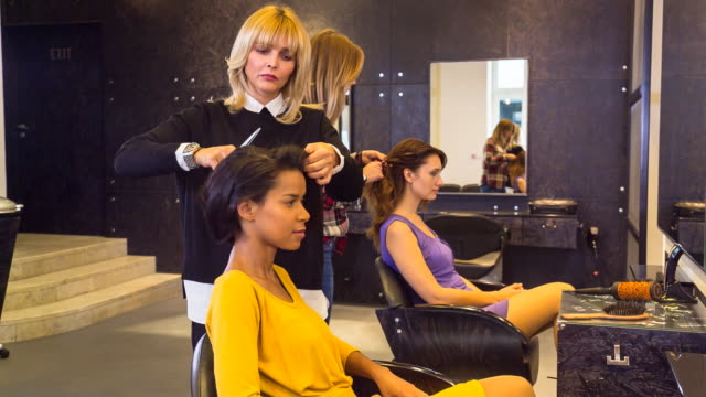 ms hairstylists doing customer´s hair in salon - hairdresser stock videos & royalty-free footage