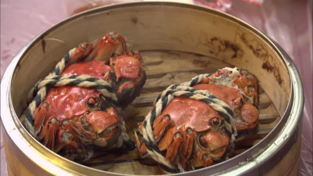 hairy crabs in a bamboo steamer, shanghai - mitten stock videos and b-roll footage