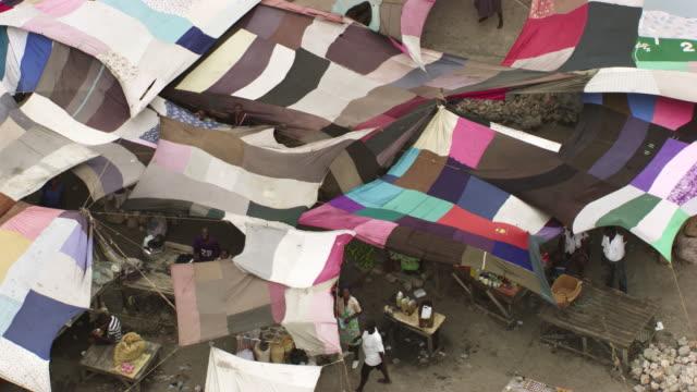haiti: market place under fabrics tent - port au prince stock videos & royalty-free footage