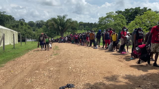 haitian migrants waiting in line to get into camp set up by the panamanian military in lajas blancas, darien province, panama, on friday, october 8,... - dirt track stock videos & royalty-free footage