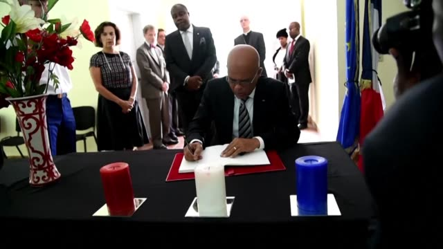 haitian president michel martelly and french ambassador to haiti elisabeth beton delegue take part in ceremony of solidarity with paris after attacks... - beton stock videos and b-roll footage