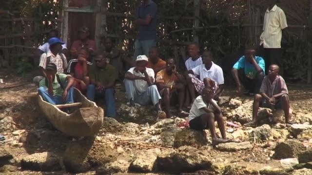 vídeos de stock e filmes b-roll de haitians waiting for help and aid following devastating earthquake haiti 11 march 2010 - hispaniola