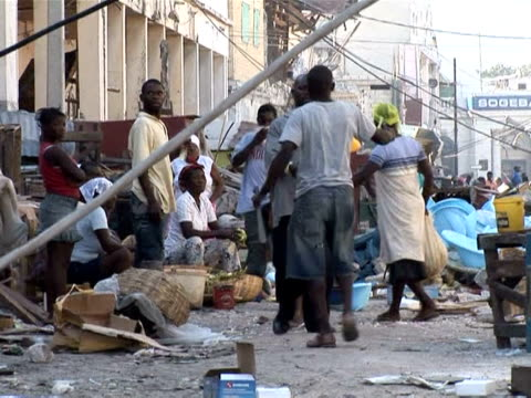 vídeos de stock e filmes b-roll de haiti's earthquake destroyed lives, homes but also thousands of businesses leaving many unemployed with no means to support themselves or their... - hispaniola