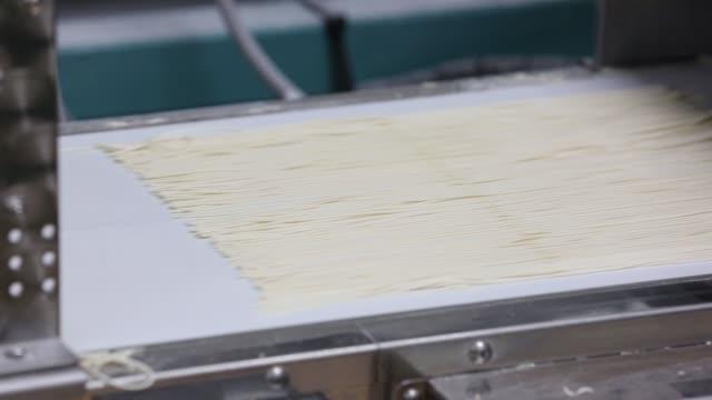 A HakataSanki Co employee prepares to make ramen noodles at the company's facility in Dazaifu Fukuoka Japan on Dec 21 Close up flour made from RaMugi...
