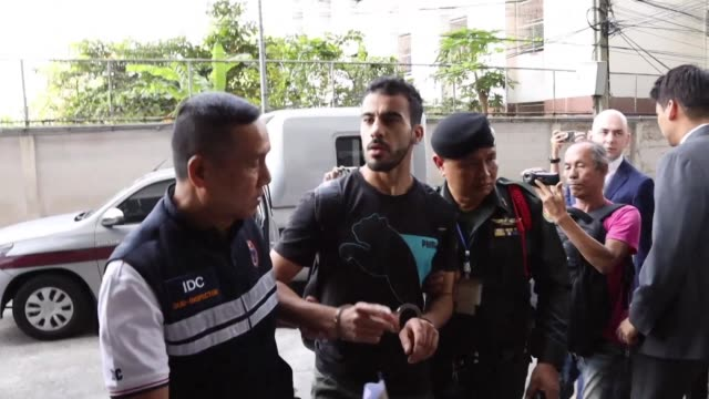 Hakeem Alaraibi refugee footballer from Bahrain facing extradition back to the Gulf state arrives at a court in Thailand for a bail hearing as he...