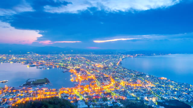 hakodate city, the night to day view from mt. hakodate, japan - day and night image series stock videos & royalty-free footage