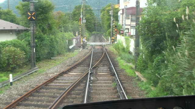 Hakone Tozan Mountain Train Passing Trough Small Stations, Tunnels And Winding Through A Narrow, Densely Wooded Valley In Hakone, Japan