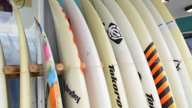 haleiwa hawaii oahu north shore shops line up of surf boards for sale - oahu stock videos and b-roll footage
