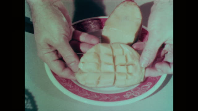 1967 half a mango fruit pushed to separate sliced sections - mango stock videos & royalty-free footage