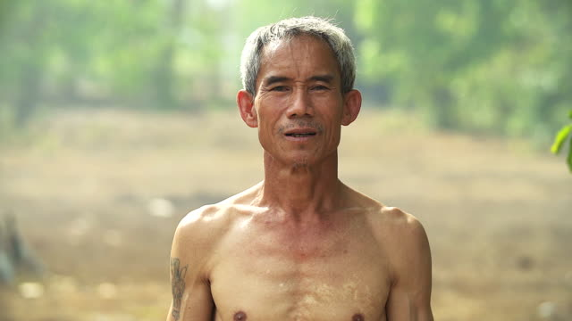 half body portrait of asian farmer.(4k) - thailand stock videos and b-roll footage