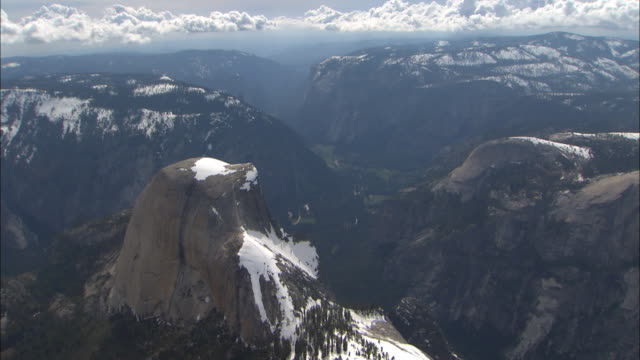 half dome and surrounding mountains overlook the yosemite valley in yosemite national park, california. - mariposa county stock videos and b-roll footage