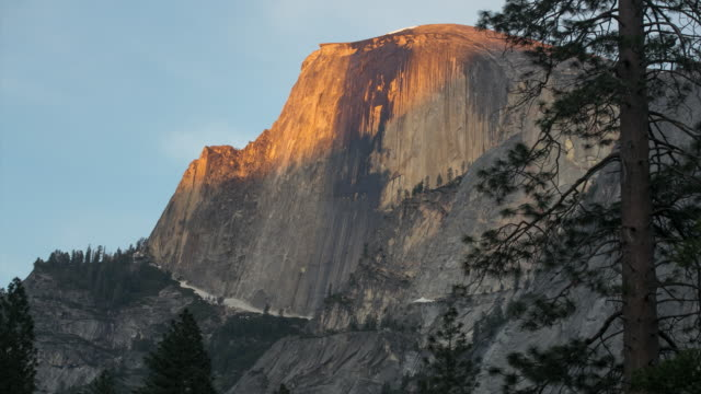 half dome in yosemite at sunset - rock face stock videos and b-roll footage