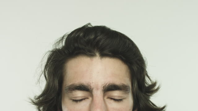 Half face of young man closing eyes