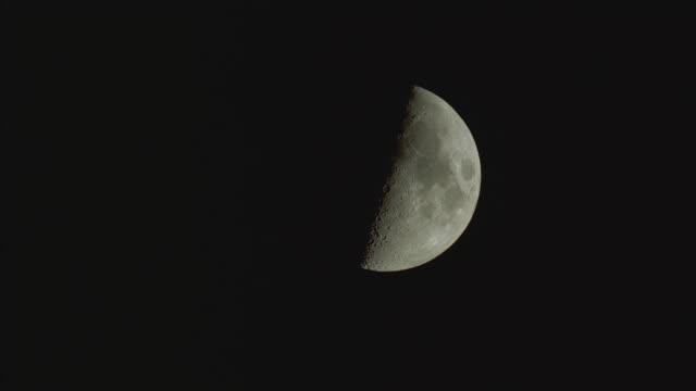 ws, half moon against black sky - half moon stock videos & royalty-free footage