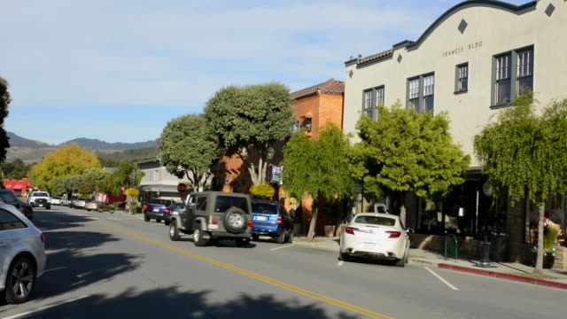 Half Moon Bay California downtown Main Street road traffic shops and cars center of town