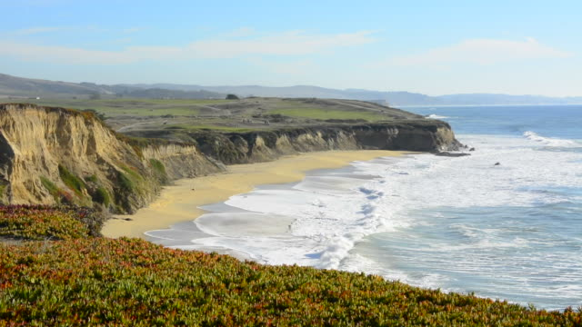 Half Moon Bay California shore ocean cliffs off of the Ritz Golf Course with waves sand at Half Moon Bay Golf Links