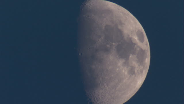 a half moon moves slowly in a dark sky. available in hd. - half moon stock videos & royalty-free footage