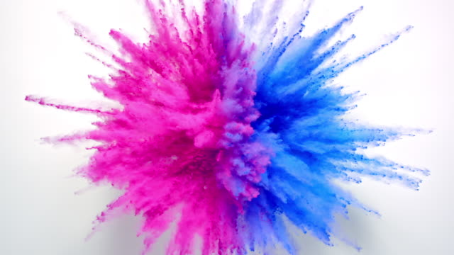 half pink and half blue colored powder exploding towards camera in close up and super slow-motion, white background - equality stock videos & royalty-free footage